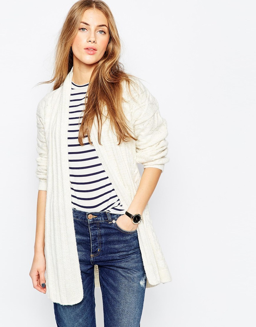 Belted Cardigan In Cable Knit Cream - neckline: shawl; style: bolero/shrug; length: below the bottom; pattern: cable knit; predominant colour: ivory/cream; occasions: casual; fibres: acrylic - mix; fit: loose; waist detail: belted waist/tie at waist/drawstring; sleeve length: long sleeve; sleeve style: standard; texture group: knits/crochet; pattern type: knitted - big stitch; pattern size: standard; season: a/w 2015; wardrobe: highlight