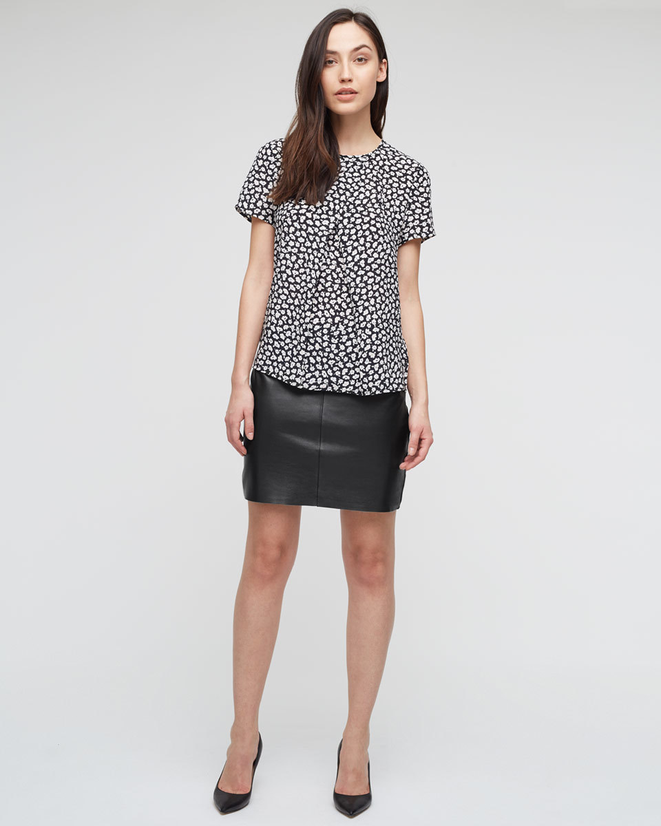 Leather Mini Skirt - length: mid thigh; pattern: plain; style: straight; fit: body skimming; waist: mid/regular rise; predominant colour: black; occasions: casual, evening, creative work; fibres: leather - 100%; texture group: leather; pattern type: fabric; pattern size: standard (bottom); season: a/w 2015; wardrobe: highlight
