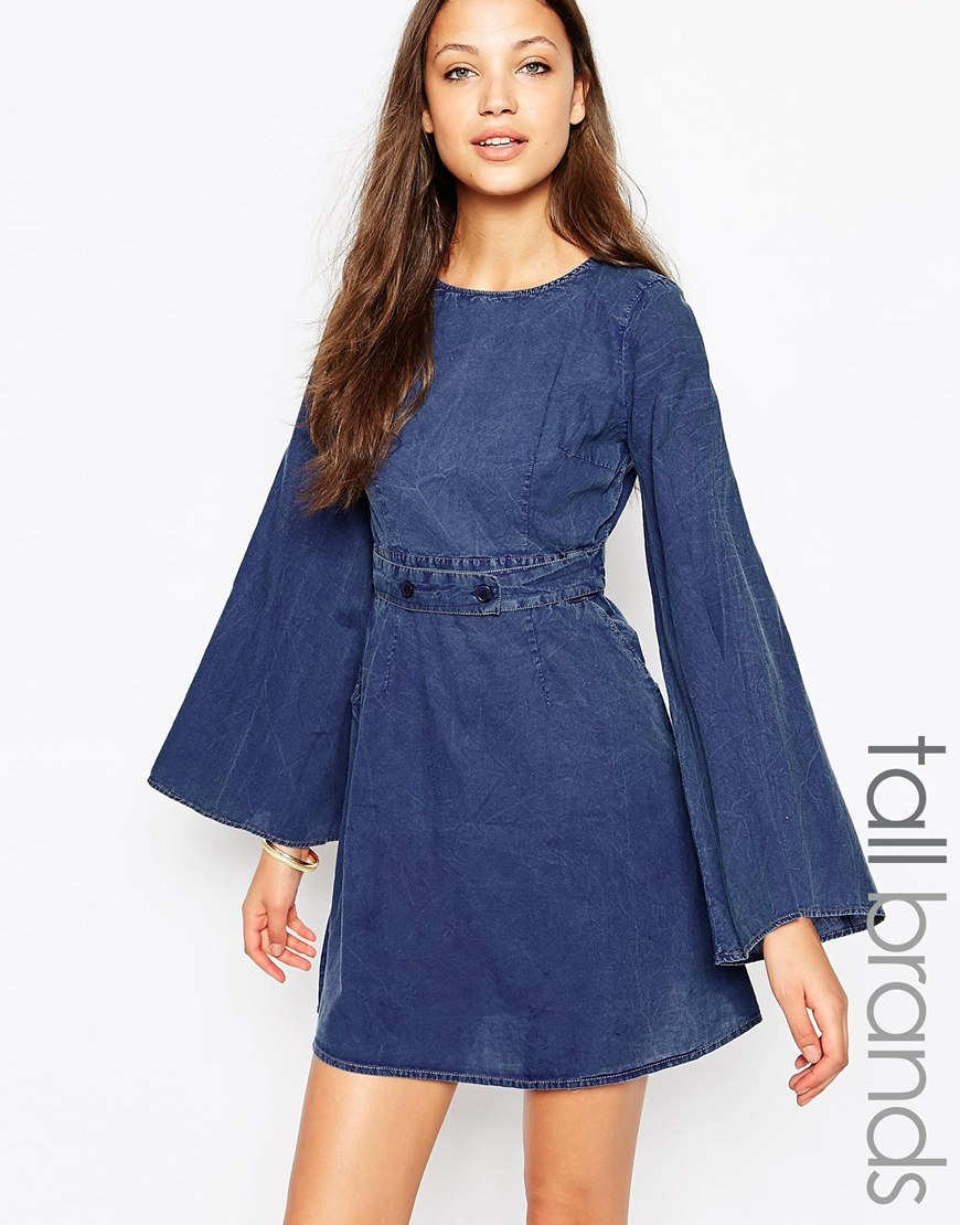 Denim Shift Dress With Buckle Detail Blue - length: mini; sleeve style: angel/waterfall; pattern: plain; predominant colour: navy; occasions: casual; fit: fitted at waist & bust; style: fit & flare; fibres: cotton - 100%; neckline: crew; sleeve length: long sleeve; texture group: denim; pattern type: fabric; season: a/w 2015; wardrobe: highlight; embellishment location: waist