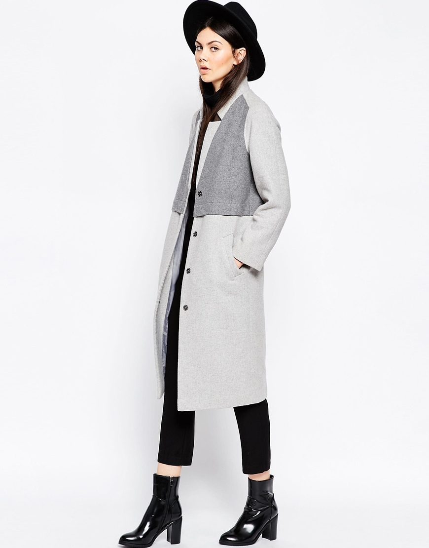 Coat In Cocoon Fit With Panel Detail Grey - style: single breasted; collar: standard lapel/rever collar; secondary colour: charcoal; predominant colour: light grey; occasions: casual, creative work; fit: straight cut (boxy); fibres: wool - mix; length: below the knee; sleeve length: long sleeve; sleeve style: standard; collar break: medium; pattern type: fabric; pattern size: standard; pattern: colourblock; texture group: woven bulky/heavy; season: a/w 2015; wardrobe: highlight