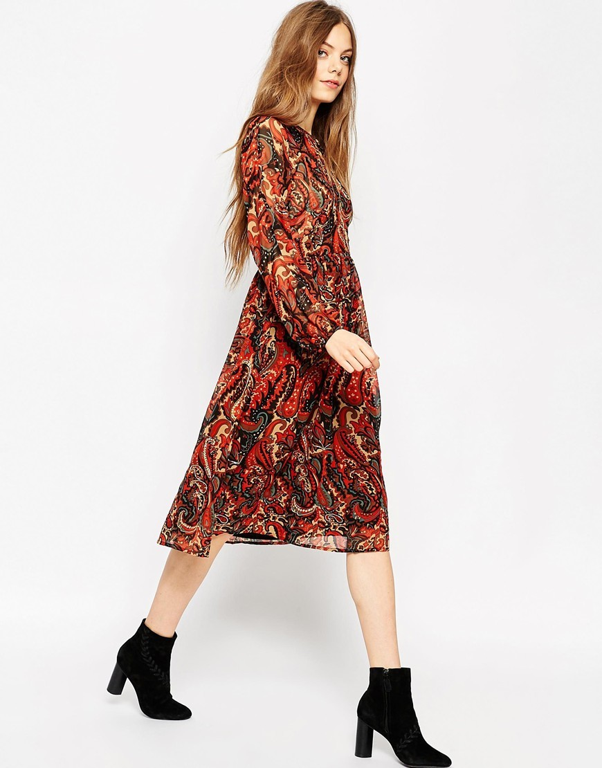 Long Sleeve Midi Dress In Folk Print With Embellishment Multi - style: shift; length: below the knee; sleeve style: bell sleeve; fit: fitted at waist; pattern: paisley; predominant colour: terracotta; secondary colour: black; occasions: casual, creative work; neckline: peep hole neckline; fibres: polyester/polyamide - 100%; sleeve length: long sleeve; texture group: sheer fabrics/chiffon/organza etc.; pattern type: fabric; pattern size: standard; multicoloured: multicoloured; season: a/w 2015