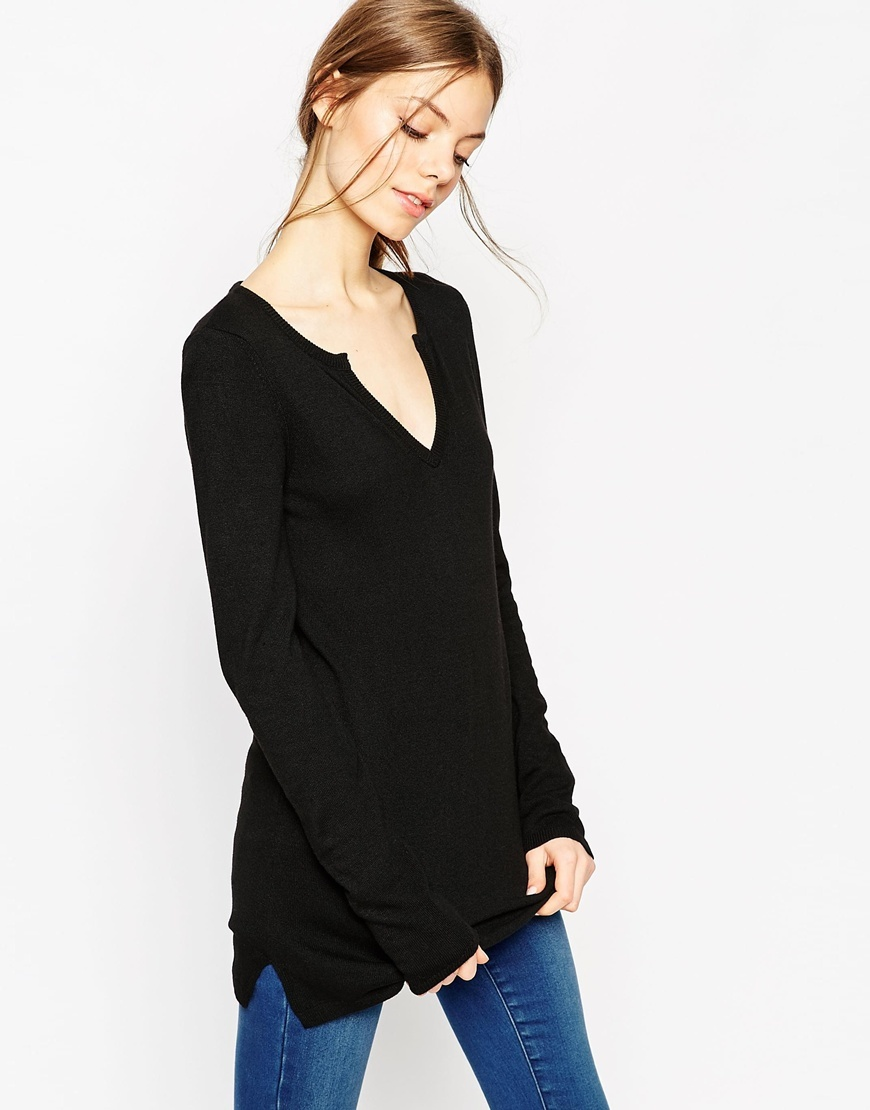 Flared Sleeve Tunic With Deep Notch V Neck In Knit Black - neckline: low v-neck; pattern: plain; length: below the bottom; style: standard; predominant colour: black; occasions: casual, creative work; fibres: wool - mix; fit: standard fit; sleeve length: long sleeve; sleeve style: standard; texture group: knits/crochet; pattern type: knitted - fine stitch; season: a/w 2015; wardrobe: basic