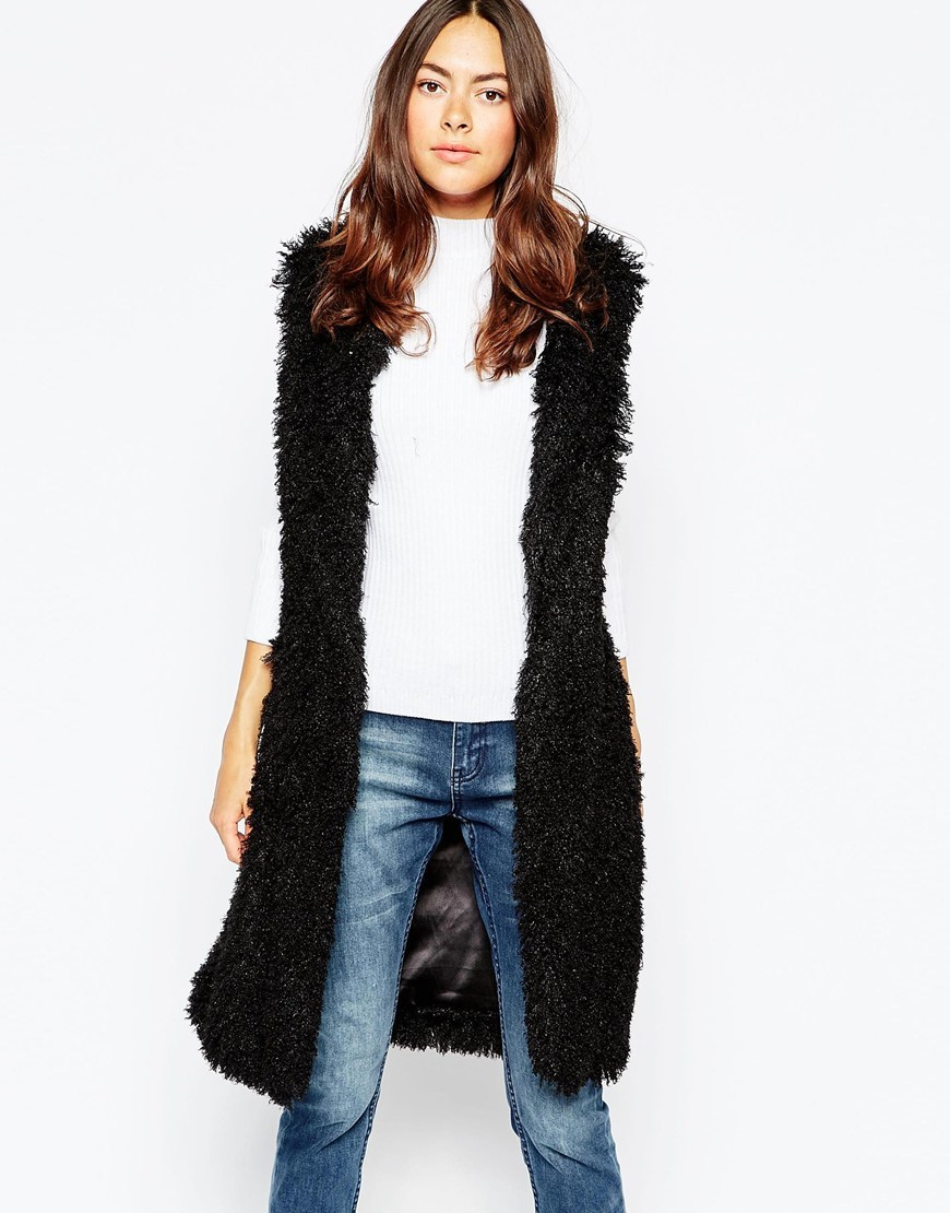 Faux Fur Long Line Gilet Black - pattern: plain; sleeve style: sleeveless; style: gilet; collar: round collar/collarless; fit: loose; length: on the knee; predominant colour: black; occasions: casual, creative work; fibres: polyester/polyamide - 100%; sleeve length: sleeveless; texture group: fur; collar break: low/open; pattern type: fabric; season: a/w 2015