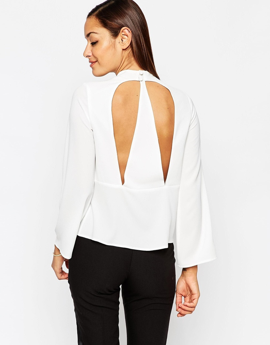 Funnel Neck Top With Open Back Ivory - pattern: plain; neckline: roll neck; predominant colour: white; occasions: evening; length: standard; style: top; fibres: polyester/polyamide - stretch; fit: body skimming; back detail: keyhole/peephole detail at back; sleeve length: long sleeve; sleeve style: standard; pattern type: fabric; texture group: other - light to midweight; season: a/w 2015; wardrobe: event
