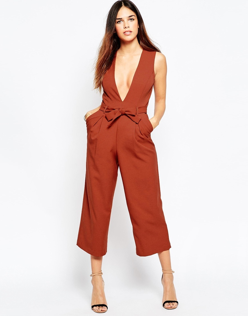 Plunge Jumpsuit With Midi Leg Burnt Orange - neckline: plunge; pattern: plain; sleeve style: sleeveless; predominant colour: terracotta; occasions: evening, occasion; length: calf length; fit: fitted at waist & bust; fibres: polyester/polyamide - 100%; sleeve length: sleeveless; style: jumpsuit; pattern type: fabric; texture group: other - light to midweight; season: a/w 2015; wardrobe: event