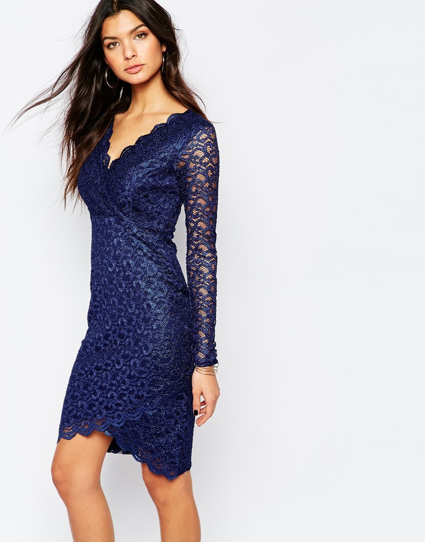 Michelle Keegan Loves Lace Scallop Bodycon Dress With Asymmetric Hem Navy Metallic - style: faux wrap/wrap; length: mid thigh; neckline: low v-neck; fit: tight; hip detail: fitted at hip; predominant colour: navy; occasions: evening, occasion; fibres: polyester/polyamide - 100%; sleeve length: long sleeve; sleeve style: standard; texture group: lace; pattern type: fabric; pattern size: standard; pattern: patterned/print; season: a/w 2015