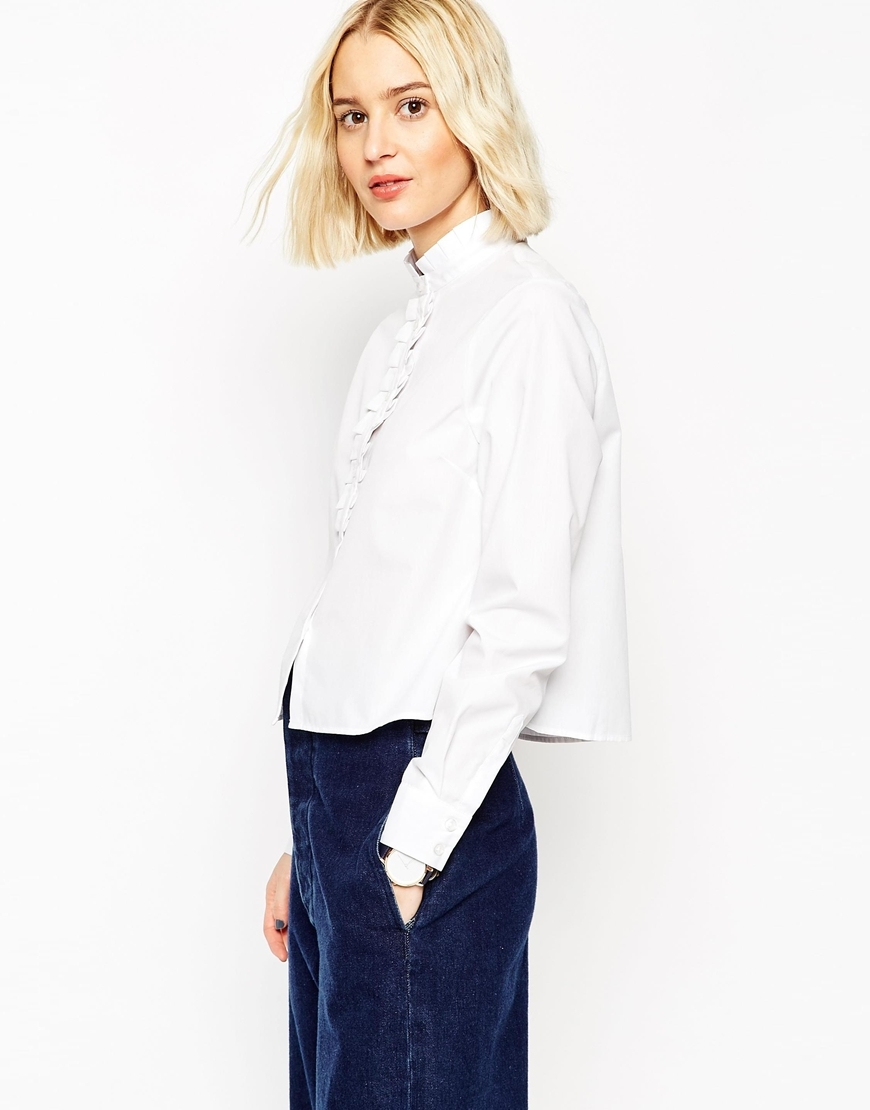 White Frill Neck Shirt With Frill Placket White - pattern: plain; style: shirt; bust detail: ruching/gathering/draping/layers/pintuck pleats at bust; predominant colour: white; occasions: casual, work, creative work; length: standard; neckline: collarstand; fibres: cotton - 100%; fit: straight cut; sleeve length: long sleeve; sleeve style: standard; pattern type: fabric; texture group: woven light midweight; season: a/w 2015; wardrobe: basic