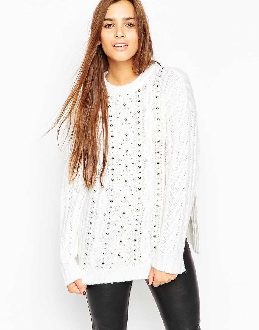 Oversized Cable Jumper With Stud Detail Cream - neckline: round neck; length: below the bottom; style: standard; pattern: cable knit; predominant colour: white; occasions: casual, creative work; fibres: acrylic - mix; fit: loose; shoulder detail: added shoulder detail; sleeve length: long sleeve; sleeve style: standard; texture group: knits/crochet; pattern type: knitted - other; pattern size: light/subtle; season: a/w 2015