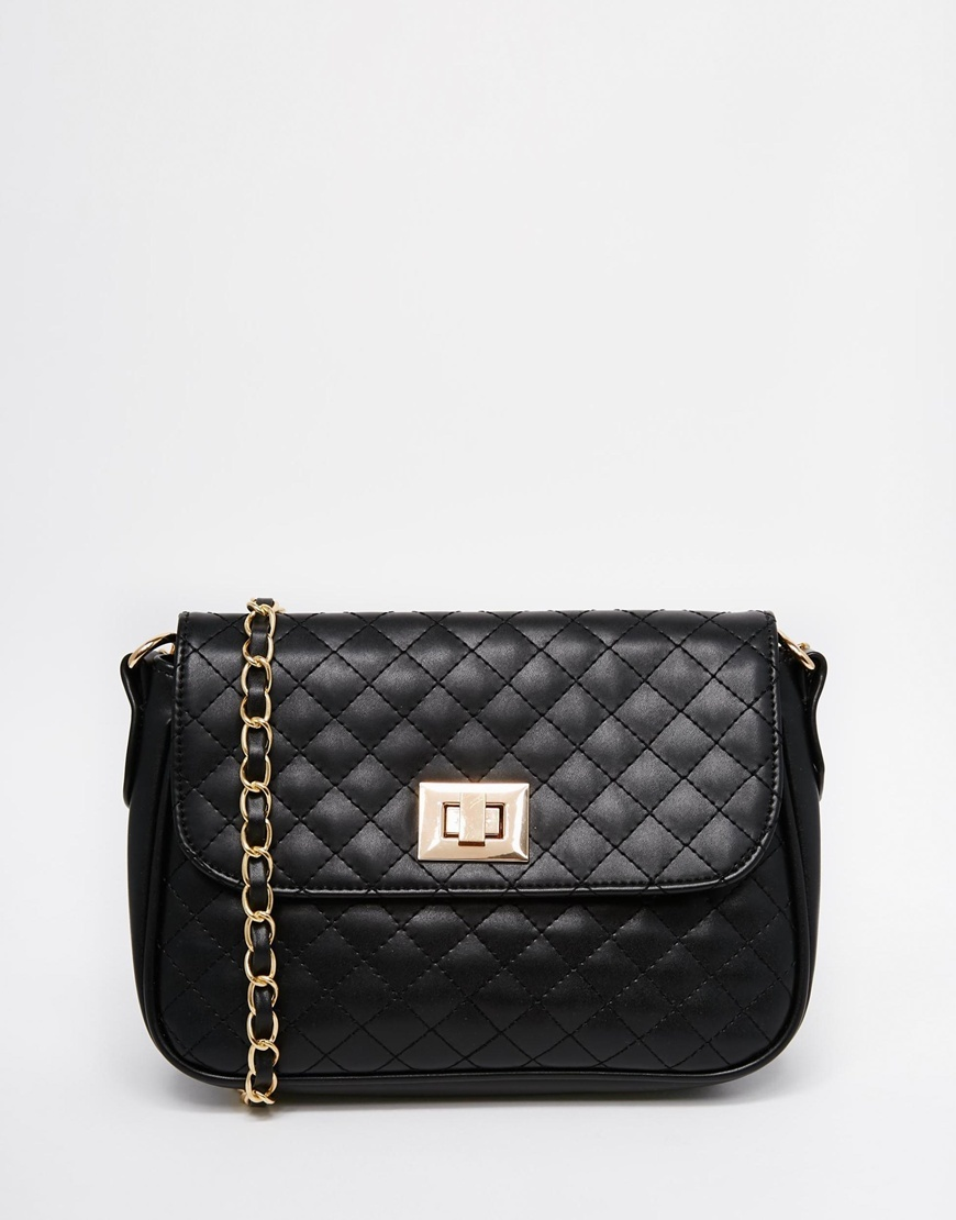 Quilted Lock Cross Body Bag Black - predominant colour: black; occasions: casual, creative work; type of pattern: standard; style: shoulder; length: across body/long; size: small; material: faux leather; embellishment: quilted; pattern: plain; finish: plain; season: a/w 2015; wardrobe: investment