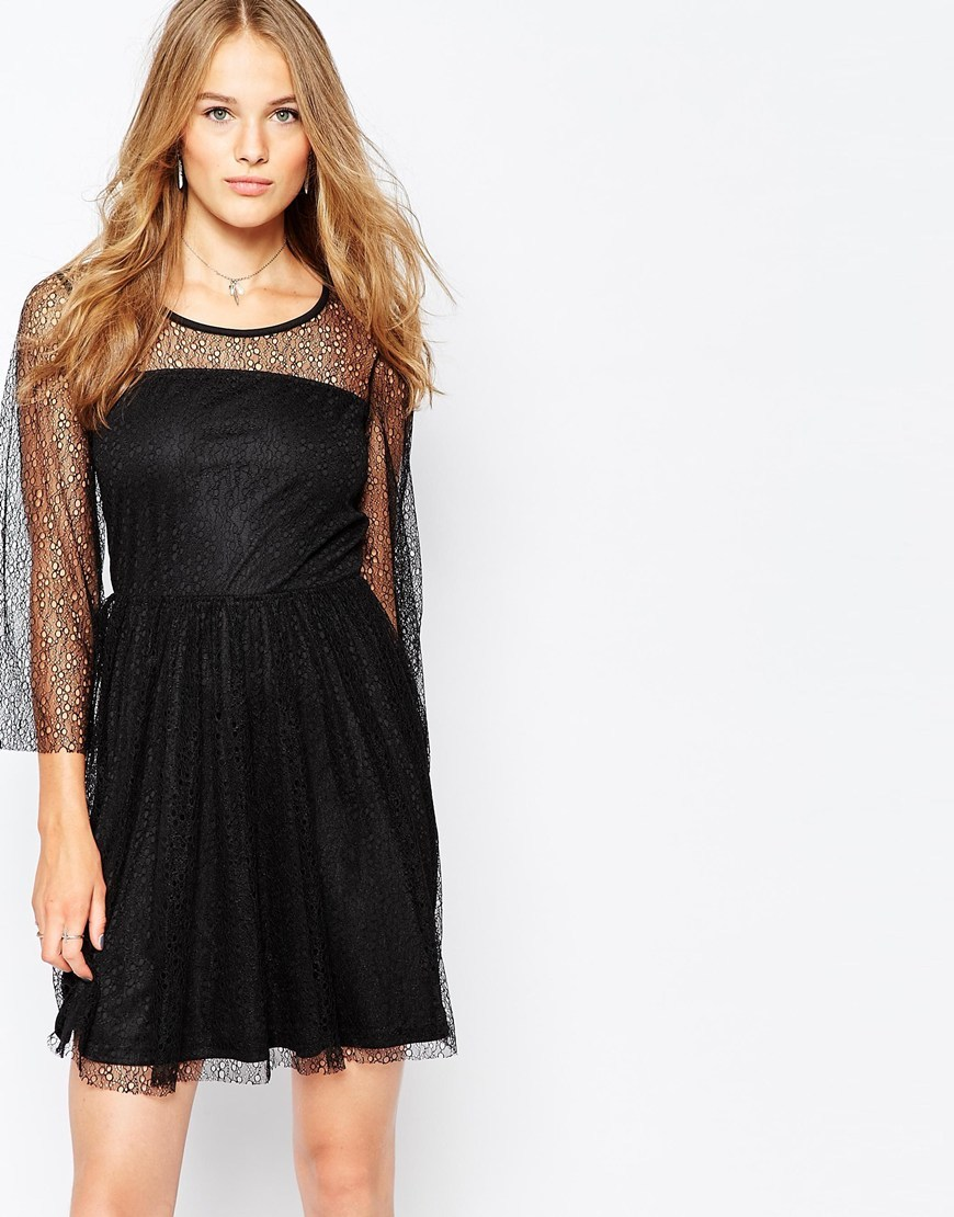 Lace Sleeve Skater Dress Black - length: mid thigh; neckline: round neck; pattern: polka dot; predominant colour: black; occasions: evening; fit: fitted at waist & bust; style: fit & flare; fibres: polyester/polyamide - 100%; hip detail: subtle/flattering hip detail; sleeve length: 3/4 length; sleeve style: standard; texture group: lace; pattern type: fabric; pattern size: light/subtle; shoulder detail: sheer at shoulder; season: a/w 2015; wardrobe: event