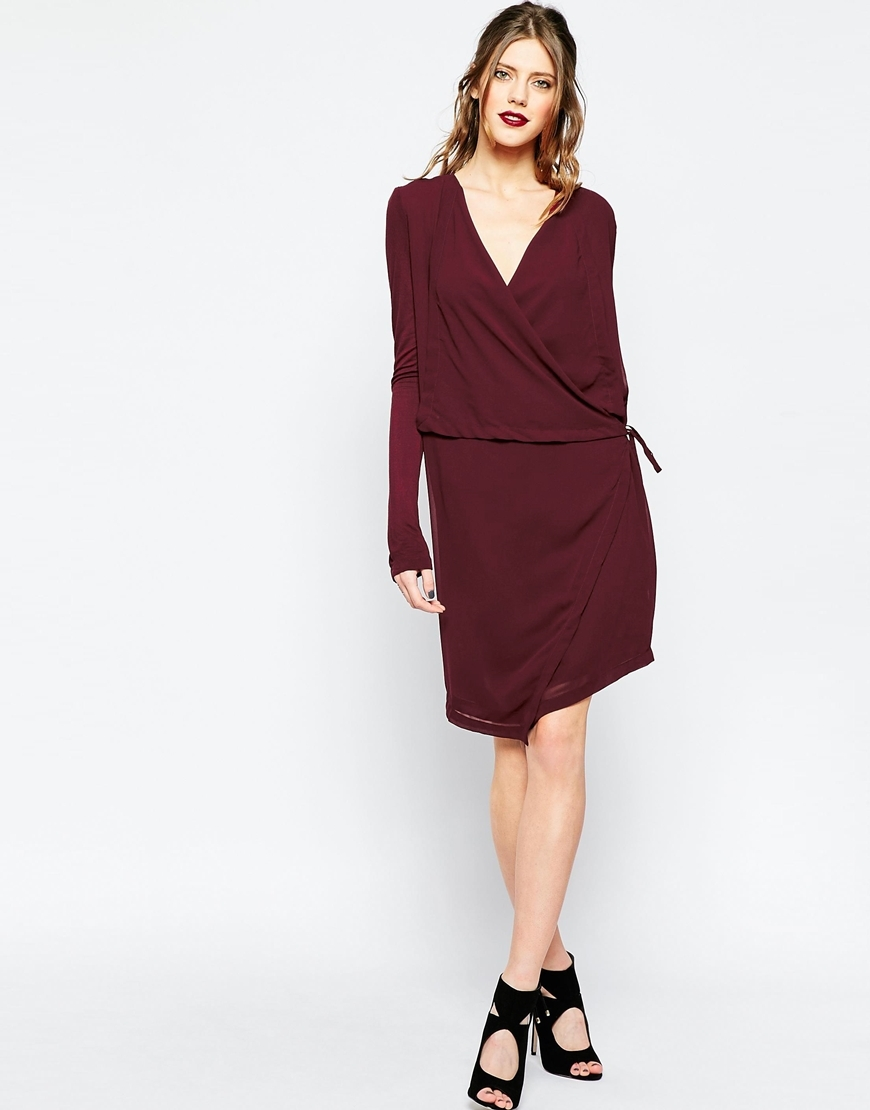 Stream Wrap Dress Black Blum - style: faux wrap/wrap; neckline: low v-neck; pattern: plain; waist detail: belted waist/tie at waist/drawstring; predominant colour: burgundy; occasions: evening, work, occasion; length: just above the knee; fit: body skimming; fibres: cotton - 100%; sleeve length: long sleeve; sleeve style: standard; pattern type: fabric; texture group: woven light midweight; season: a/w 2015; wardrobe: highlight