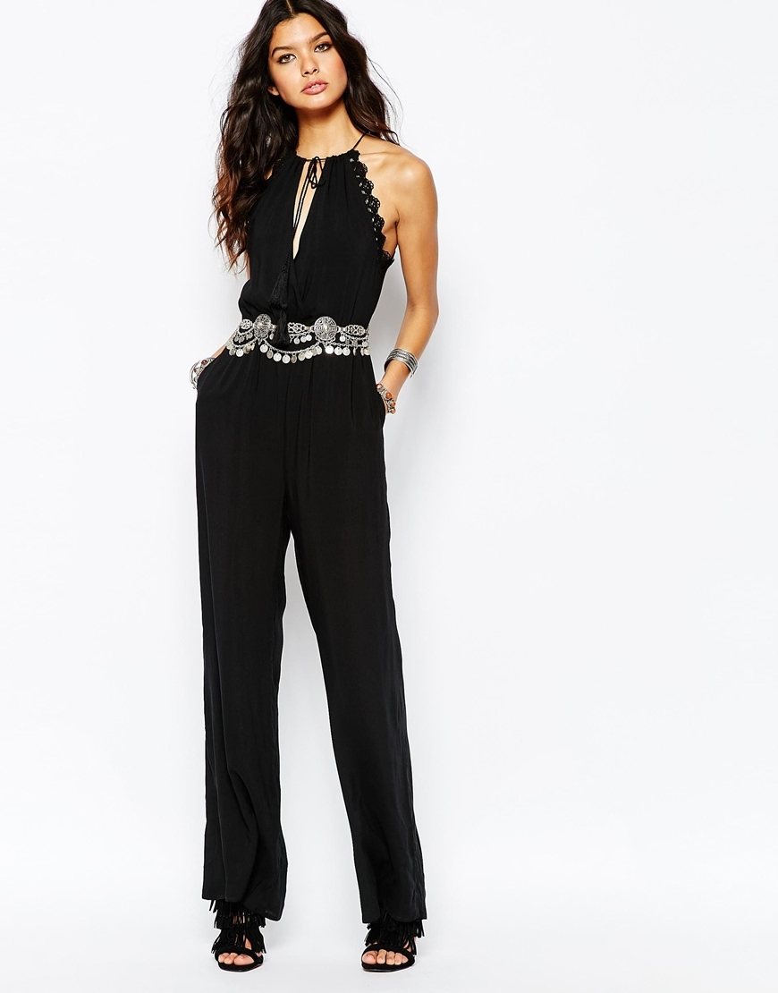 Scallop Trim Jumpsuit With Crochet Detail Black - length: standard; pattern: plain; sleeve style: sleeveless; waist detail: embellishment at waist/feature waistband; predominant colour: black; occasions: evening; fit: body skimming; neckline: peep hole neckline; fibres: polyester/polyamide - 100%; sleeve length: sleeveless; style: jumpsuit; pattern type: fabric; texture group: other - light to midweight; embellishment: lace; season: a/w 2015
