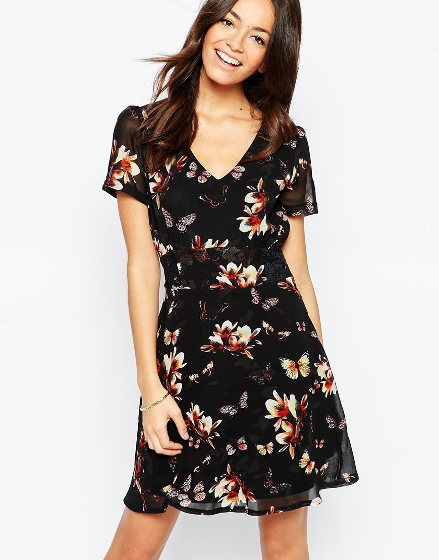 Tea Dress In Butterfly Floral Print Black - style: shift; neckline: v-neck; predominant colour: ivory/cream; secondary colour: black; occasions: casual, evening, creative work; length: just above the knee; fit: soft a-line; fibres: polyester/polyamide - 100%; sleeve length: short sleeve; sleeve style: standard; texture group: sheer fabrics/chiffon/organza etc.; pattern type: fabric; pattern size: big & busy; pattern: florals; multicoloured: multicoloured; season: a/w 2015; wardrobe: highlight