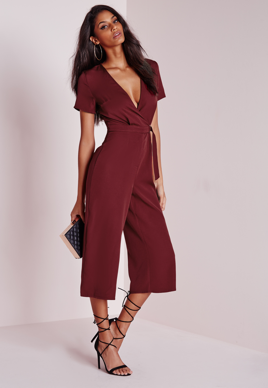 D Ring Wrap Culotte Jumpsuit Burgundy, Burgundy - neckline: plunge; fit: fitted at waist; pattern: plain; waist detail: belted waist/tie at waist/drawstring; predominant colour: burgundy; occasions: evening, occasion; length: calf length; fibres: polyester/polyamide - stretch; sleeve length: short sleeve; sleeve style: standard; style: jumpsuit; pattern type: fabric; texture group: jersey - stretchy/drapey; season: a/w 2015; wardrobe: event