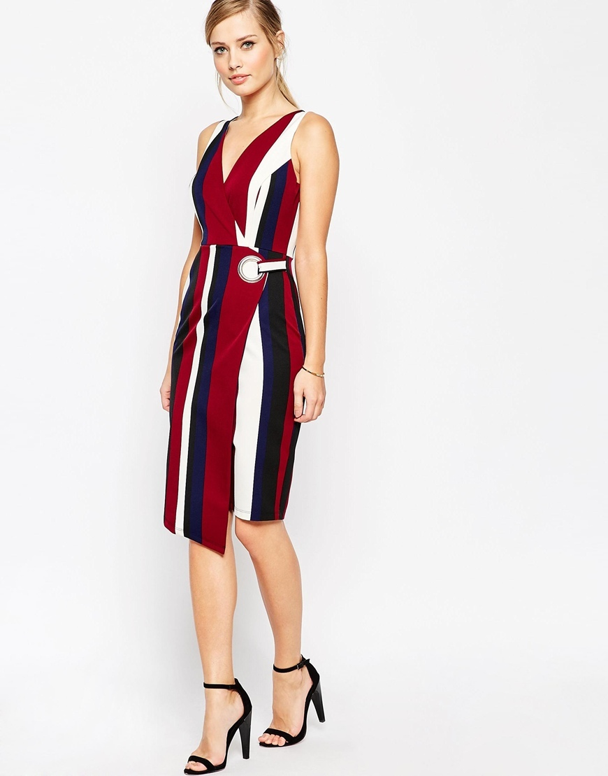 Wrap Pencil Dress In Bold Stripe Print With Eyelet Print - style: faux wrap/wrap; neckline: v-neck; sleeve style: standard vest straps/shoulder straps; pattern: vertical stripes; predominant colour: burgundy; secondary colour: navy; occasions: evening, occasion; length: on the knee; fit: fitted at waist & bust; fibres: polyester/polyamide - 100%; sleeve length: sleeveless; pattern type: fabric; pattern size: standard; texture group: other - light to midweight; multicoloured: multicoloured; season: a/w 2015; wardrobe: event