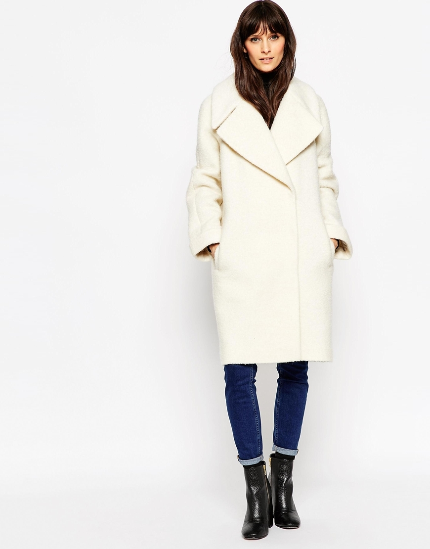 Coat In Oversized Fit With Turn Back Cuff Cream - pattern: plain; collar: wide lapels; length: mid thigh; predominant colour: ivory/cream; occasions: casual, work, creative work; fit: straight cut (boxy); style: cocoon; fibres: wool - mix; sleeve length: long sleeve; sleeve style: standard; collar break: medium; pattern type: fabric; texture group: woven bulky/heavy; season: a/w 2015; wardrobe: basic