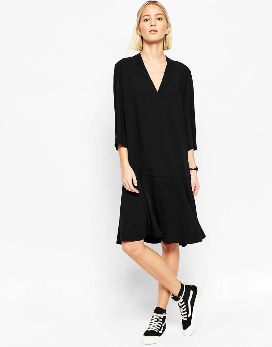 Flippy Skirt Midi Dress Black - style: shift; neckline: v-neck; fit: loose; pattern: plain; predominant colour: black; occasions: evening; length: on the knee; fibres: polyester/polyamide - 100%; sleeve length: 3/4 length; sleeve style: standard; pattern type: fabric; texture group: other - light to midweight; season: a/w 2015; wardrobe: event
