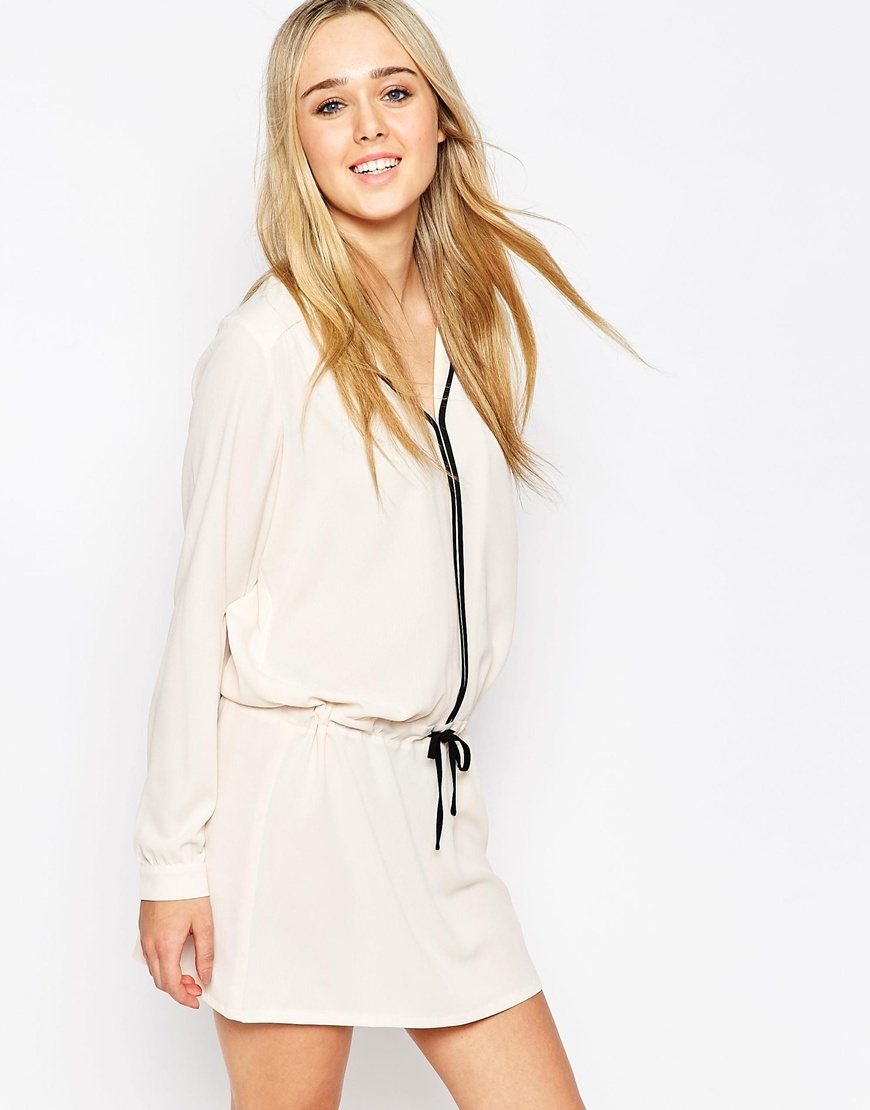 Curiouser And Curiouser Shirt Dress Cream - style: shirt; length: mid thigh; neckline: v-neck; pattern: plain; waist detail: belted waist/tie at waist/drawstring; predominant colour: ivory/cream; secondary colour: black; occasions: evening; fit: body skimming; fibres: polyester/polyamide - stretch; sleeve length: long sleeve; sleeve style: standard; texture group: crepes; pattern type: fabric; season: a/w 2015