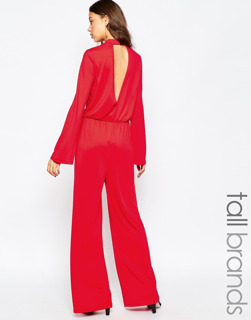 Tall Keyhole Back Wide Leg Jumpsuit Red - length: standard; fit: fitted at waist; pattern: plain; waist detail: elasticated waist; predominant colour: true red; fibres: polyester/polyamide - stretch; occasions: occasion; neckline: crew; sleeve length: long sleeve; sleeve style: standard; style: jumpsuit; pattern type: fabric; texture group: other - light to midweight; season: a/w 2015; wardrobe: event