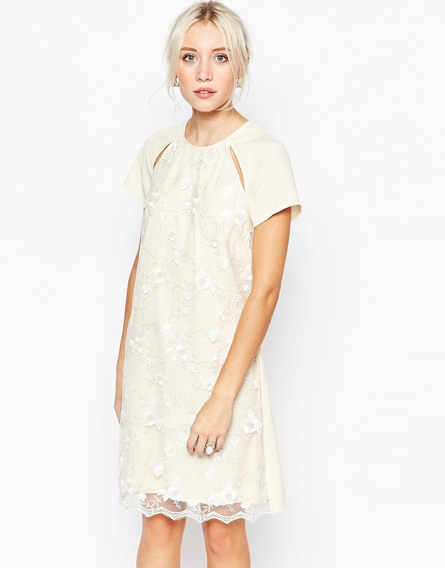 Embroidered Cut Out Tunic Dress Cream - style: tunic; sleeve style: raglan; predominant colour: ivory/cream; occasions: evening, occasion; length: just above the knee; fit: straight cut; fibres: polyester/polyamide - 100%; neckline: crew; shoulder detail: cut out shoulder; sleeve length: short sleeve; texture group: lace; pattern type: fabric; pattern size: standard; pattern: patterned/print; embellishment: embroidered; season: a/w 2015