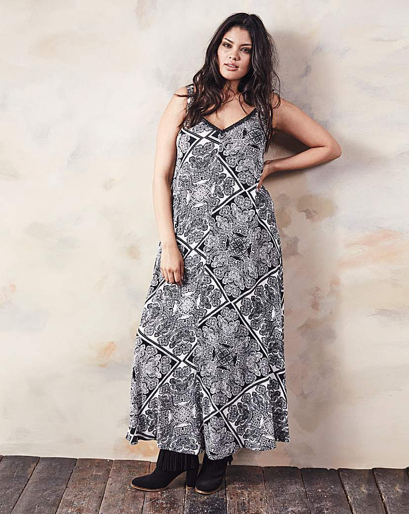 Black/Ivory Paisley Print Maxi Dress - neckline: low v-neck; sleeve style: sleeveless; style: maxi dress; length: ankle length; secondary colour: white; predominant colour: black; occasions: casual; fit: soft a-line; fibres: polyester/polyamide - stretch; hip detail: subtle/flattering hip detail; sleeve length: sleeveless; pattern type: fabric; pattern: patterned/print; texture group: jersey - stretchy/drapey; season: a/w 2015; wardrobe: highlight