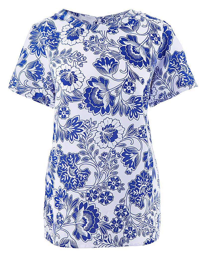 Blue Floral Shell Top - length: below the bottom; predominant colour: royal blue; secondary colour: pale blue; occasions: casual; style: top; fibres: cotton - mix; fit: body skimming; neckline: crew; sleeve length: short sleeve; sleeve style: standard; pattern type: fabric; pattern: florals; texture group: woven light midweight; pattern size: big & busy (top); season: a/w 2015