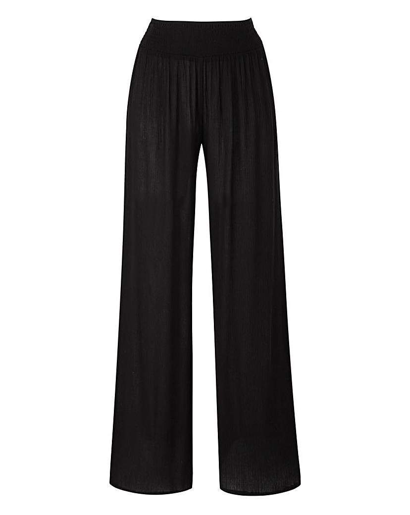 Crinkle Wide Leg Trouser Regular - length: standard; pattern: plain; waist: high rise; predominant colour: black; occasions: casual, creative work; fibres: viscose/rayon - 100%; waist detail: narrow waistband; fit: baggy; pattern type: fabric; texture group: jersey - stretchy/drapey; style: standard; season: a/w 2015