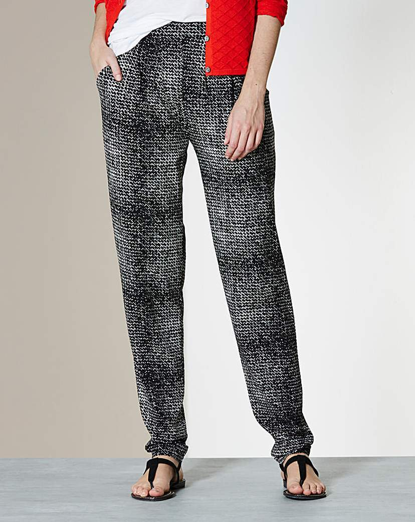 Printed Harem Jersey Trousers Regular - length: standard; style: harem/slouch; waist detail: elasticated waist; waist: mid/regular rise; secondary colour: white; predominant colour: black; occasions: casual; fibres: polyester/polyamide - stretch; trends: monochrome; fit: baggy; pattern type: fabric; pattern: patterned/print; texture group: jersey - stretchy/drapey; pattern size: big & busy (bottom); season: a/w 2015