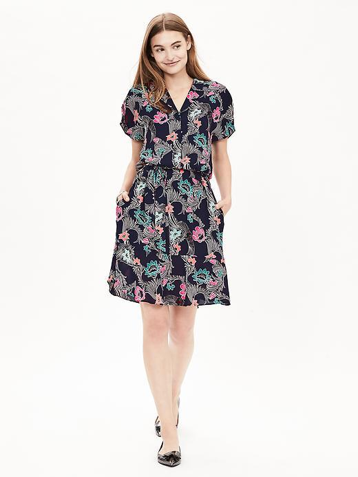 Print Belted Flounce Shirtdress Preppy Navy - style: shift; neckline: v-neck; waist detail: belted waist/tie at waist/drawstring; secondary colour: pink; predominant colour: navy; occasions: casual; length: just above the knee; fit: body skimming; fibres: polyester/polyamide - 100%; sleeve length: short sleeve; sleeve style: standard; pattern type: fabric; pattern: florals; texture group: woven light midweight; multicoloured: multicoloured; season: a/w 2015