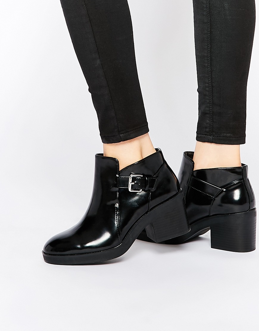 Patent Cut Out Boot Black - predominant colour: black; occasions: casual, creative work; material: faux leather; heel height: mid; embellishment: buckles; heel: block; toe: round toe; boot length: ankle boot; style: standard; finish: patent; pattern: plain; season: a/w 2015