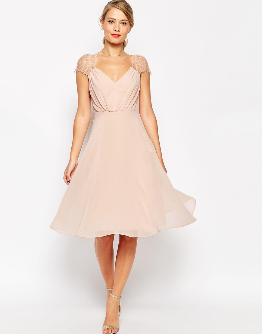 Kate Lace Midi Dress Nude - length: below the knee; neckline: v-neck; sleeve style: capped; pattern: plain; style: prom dress; bust detail: subtle bust detail; predominant colour: blush; occasions: evening, occasion; fit: fitted at waist & bust; fibres: polyester/polyamide - 100%; hip detail: subtle/flattering hip detail; sleeve length: short sleeve; texture group: sheer fabrics/chiffon/organza etc.; pattern type: fabric; shoulder detail: sheer at shoulder; season: a/w 2015; wardrobe: event
