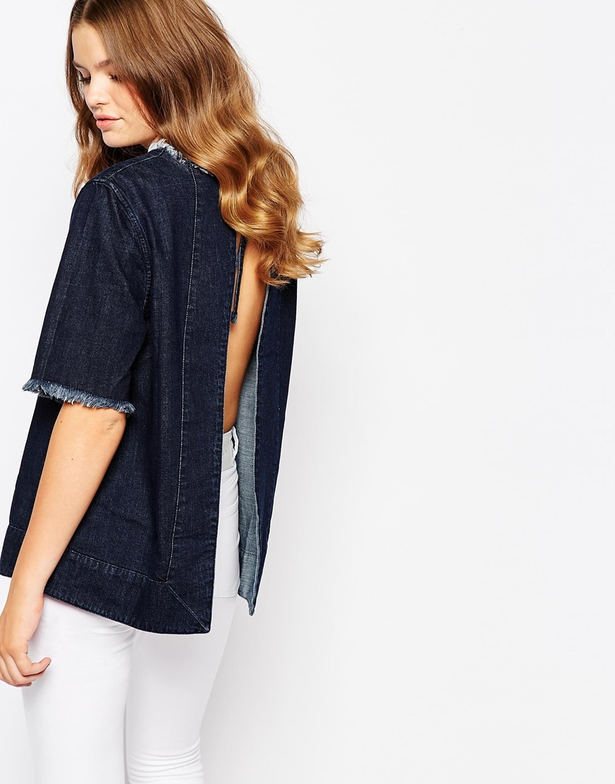 Jessika Open Back Denim Top Marcus Blue - pattern: plain; back detail: low cut/open back; predominant colour: navy; occasions: casual; length: standard; style: top; fibres: cotton - stretch; fit: straight cut; neckline: crew; sleeve length: short sleeve; sleeve style: standard; texture group: denim; pattern type: fabric; season: a/w 2015