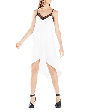Astrella Asymmetric Draped Slip Dress - neckline: v-neck; sleeve style: spaghetti straps; fit: loose; pattern: plain; predominant colour: white; secondary colour: black; occasions: evening; length: just above the knee; style: slip dress; fibres: polyester/polyamide - mix; back detail: longer hem at back than at front; sleeve length: sleeveless; texture group: sheer fabrics/chiffon/organza etc.; pattern type: fabric; embellishment: lace; season: a/w 2015; wardrobe: event; embellishment location: neck