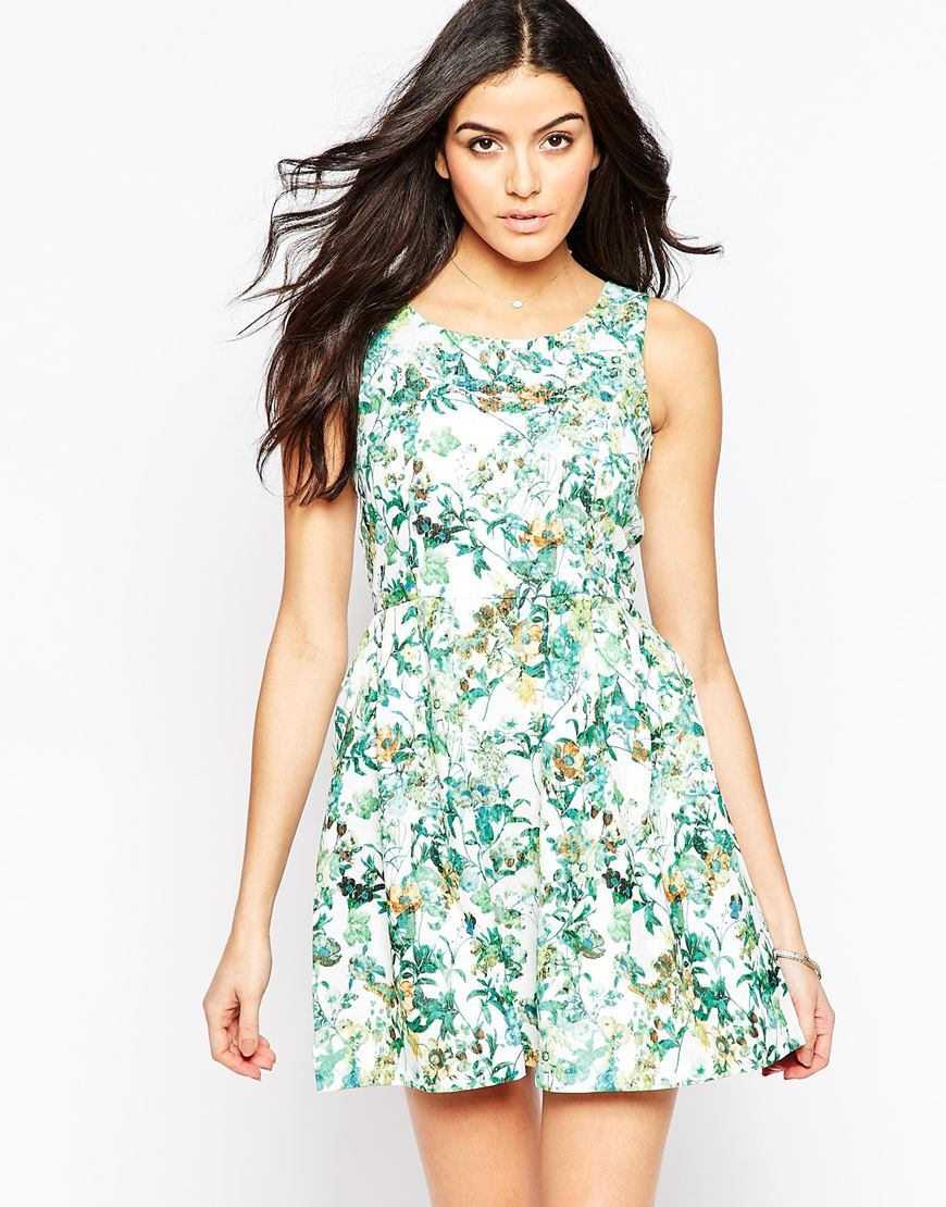 Floral Skater Dress White/Green - length: mid thigh; neckline: round neck; sleeve style: sleeveless; predominant colour: white; secondary colour: mint green; occasions: evening; fit: fitted at waist & bust; style: fit & flare; fibres: polyester/polyamide - 100%; sleeve length: sleeveless; pattern type: fabric; pattern: florals; texture group: jersey - stretchy/drapey; multicoloured: multicoloured; season: a/w 2015