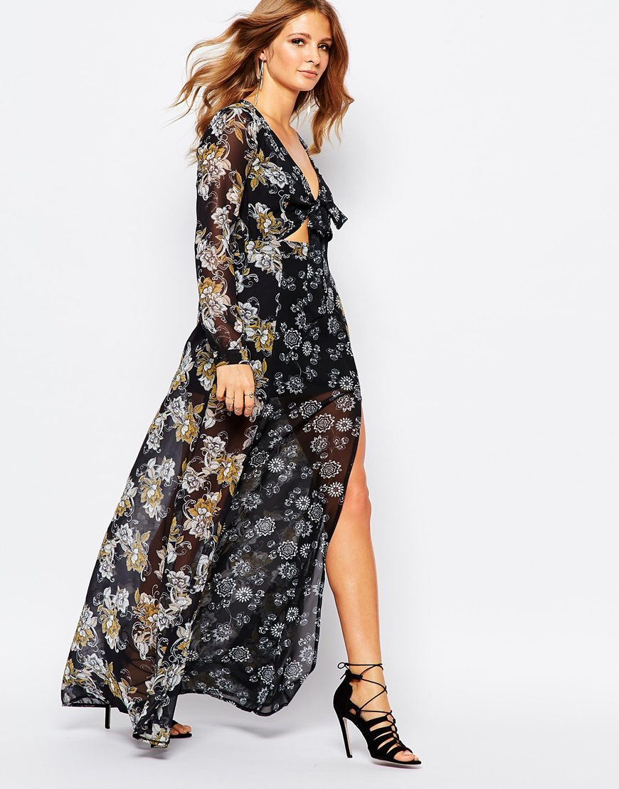 Maxi Dress In 70s Floral Print 11025 Col - neckline: low v-neck; style: maxi dress; secondary colour: light grey; predominant colour: black; occasions: evening; length: floor length; fit: body skimming; fibres: polyester/polyamide - 100%; hip detail: slits at hip; waist detail: cut out detail; sleeve length: long sleeve; sleeve style: standard; pattern type: fabric; pattern size: big & busy; pattern: florals; texture group: other - light to midweight; multicoloured: multicoloured; season: a/w 2015; wardrobe: event