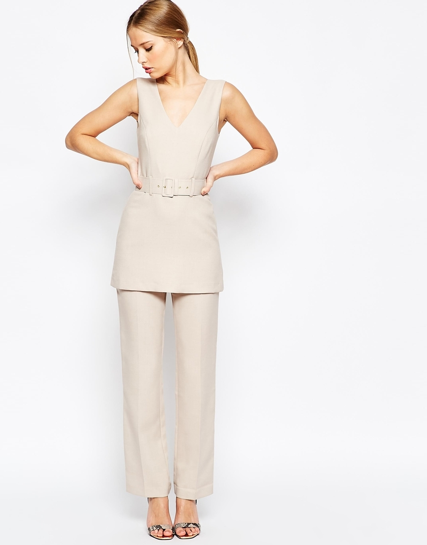 Jumpsuit With Tunic Detail Beige - length: standard; neckline: low v-neck; fit: tailored/fitted; pattern: plain; sleeve style: sleeveless; waist detail: belted waist/tie at waist/drawstring; predominant colour: ivory/cream; fibres: polyester/polyamide - 100%; occasions: occasion; sleeve length: sleeveless; style: jumpsuit; pattern type: fabric; texture group: other - light to midweight; season: a/w 2015; wardrobe: event