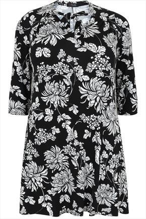 Black & White Floral Longline Swing Top With Soft Neck Tie - neckline: pussy bow; secondary colour: white; predominant colour: black; occasions: casual; style: top; fibres: polyester/polyamide - stretch; fit: straight cut; length: mid thigh; sleeve length: 3/4 length; sleeve style: standard; pattern type: fabric; pattern: patterned/print; texture group: jersey - stretchy/drapey; pattern size: big & busy (top); season: a/w 2015; wardrobe: highlight