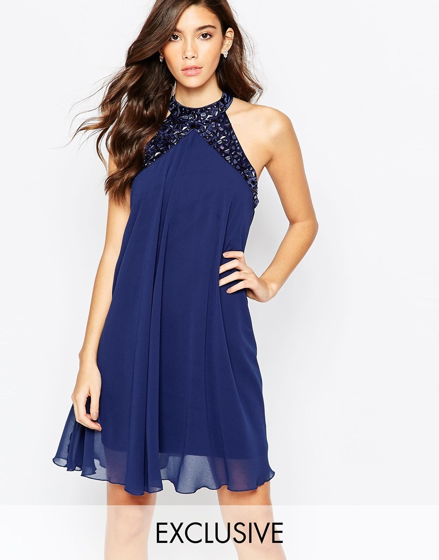 Embellished High Neck Babydoll Swing Dress Navy - style: shift; pattern: plain; sleeve style: sleeveless; neckline: high neck; predominant colour: navy; occasions: evening, occasion; length: just above the knee; fit: soft a-line; fibres: polyester/polyamide - 100%; sleeve length: sleeveless; texture group: sheer fabrics/chiffon/organza etc.; pattern type: fabric; embellishment: sequins; season: a/w 2015; wardrobe: event