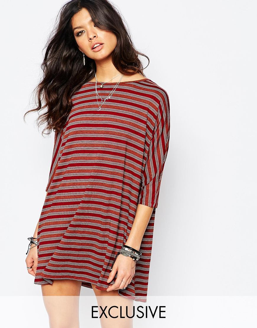 Stripe Shift Dress Multi - style: tunic; length: mid thigh; neckline: slash/boat neckline; sleeve style: dolman/batwing; fit: loose; pattern: horizontal stripes; predominant colour: burgundy; occasions: casual; fibres: polyester/polyamide - 100%; sleeve length: 3/4 length; pattern type: fabric; pattern size: standard; texture group: jersey - stretchy/drapey; secondary colour: raspberry; multicoloured: multicoloured; season: a/w 2015; wardrobe: highlight