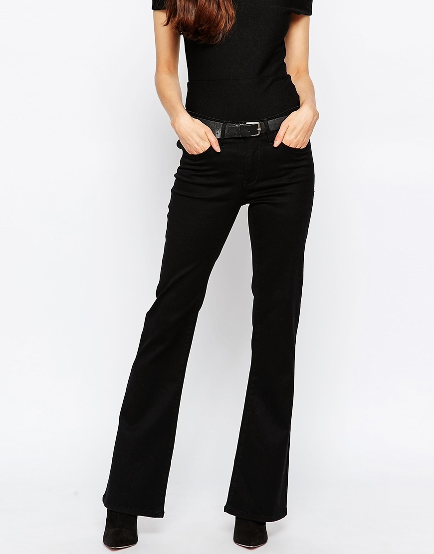 Black Flare Jeans Black - style: flares; length: standard; pattern: plain; waist: mid/regular rise; predominant colour: black; occasions: casual, creative work; fibres: cotton - stretch; texture group: denim; pattern type: fabric; season: a/w 2015; wardrobe: basic