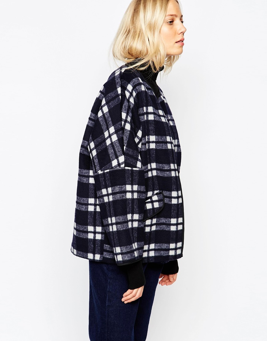 Katarina Coat In Wool Check Navy - sleeve style: dolman/batwing; pattern: checked/gingham; length: below the bottom; collar: funnel; style: parka; secondary colour: white; predominant colour: black; occasions: casual; fit: straight cut (boxy); fibres: wool - mix; sleeve length: long sleeve; collar break: high/illusion of break when open; pattern type: fabric; pattern size: standard; texture group: woven bulky/heavy; season: a/w 2015; wardrobe: highlight