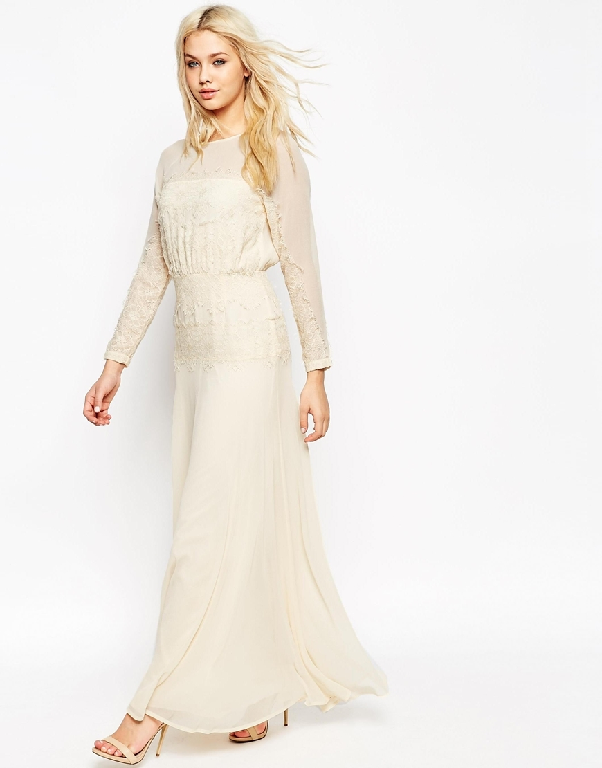 Delicate Lace Panelled Maxi Dress Cream - fit: fitted at waist; style: maxi dress; length: ankle length; predominant colour: ivory/cream; occasions: evening, occasion; fibres: polyester/polyamide - 100%; neckline: crew; sleeve length: long sleeve; sleeve style: standard; texture group: sheer fabrics/chiffon/organza etc.; pattern type: fabric; pattern size: light/subtle; pattern: patterned/print; shoulder detail: sheer at shoulder; season: a/w 2015; wardrobe: event; embellishment: contrast fabric; embellishment location: bust