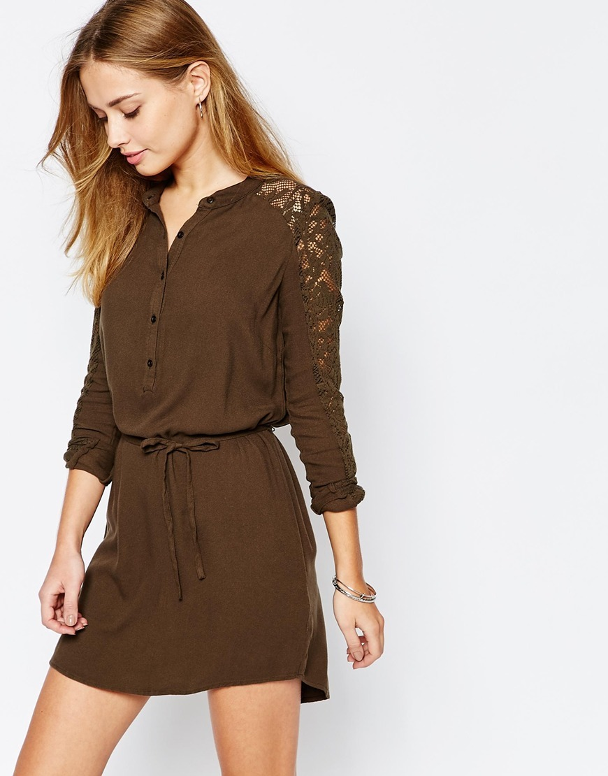 Lace Sleeve Belted Shirt Dress Olive Green - style: shirt; length: mini; fit: fitted at waist; pattern: plain; waist detail: belted waist/tie at waist/drawstring; predominant colour: chocolate brown; occasions: casual, evening; neckline: collarstand & mandarin with v-neck; fibres: viscose/rayon - 100%; sleeve length: 3/4 length; sleeve style: standard; texture group: crepes; pattern type: fabric; embellishment: lace; season: a/w 2015; wardrobe: highlight