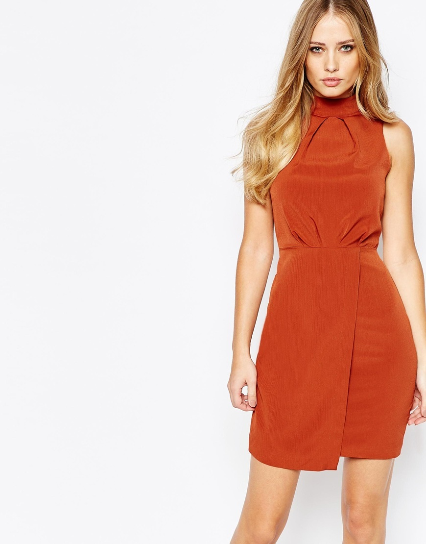 Spice Dress With Wrap Skirt Spice - style: shift; length: mini; pattern: plain; sleeve style: sleeveless; neckline: high neck; hip detail: draws attention to hips; predominant colour: bright orange; occasions: evening, occasion; fit: fitted at waist & bust; fibres: polyester/polyamide - 100%; sleeve length: sleeveless; bust detail: bulky details at bust; pattern type: fabric; texture group: other - light to midweight; season: a/w 2015; wardrobe: event
