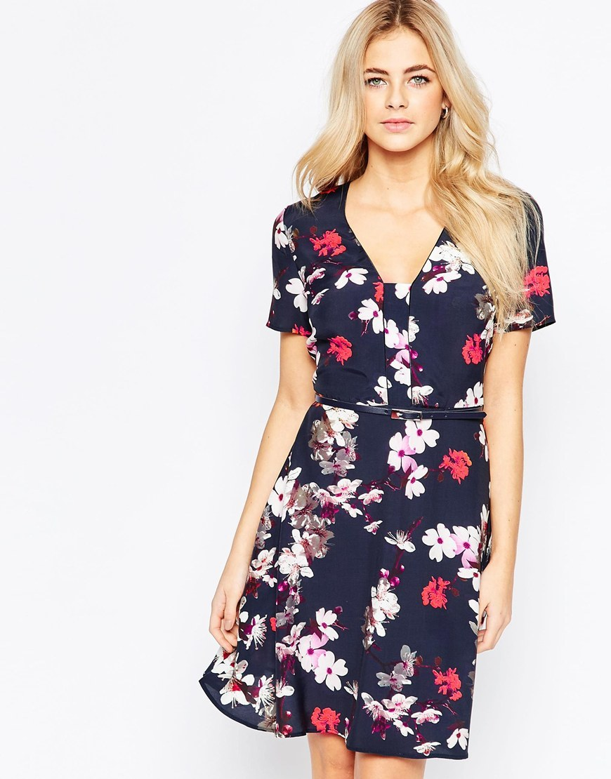 Blossom Print Dress Multi - neckline: low v-neck; secondary colour: true red; predominant colour: navy; occasions: casual; length: just above the knee; fit: fitted at waist & bust; style: fit & flare; fibres: viscose/rayon - 100%; sleeve length: short sleeve; sleeve style: standard; pattern type: fabric; pattern: florals; texture group: other - light to midweight; multicoloured: multicoloured; season: a/w 2015; wardrobe: highlight
