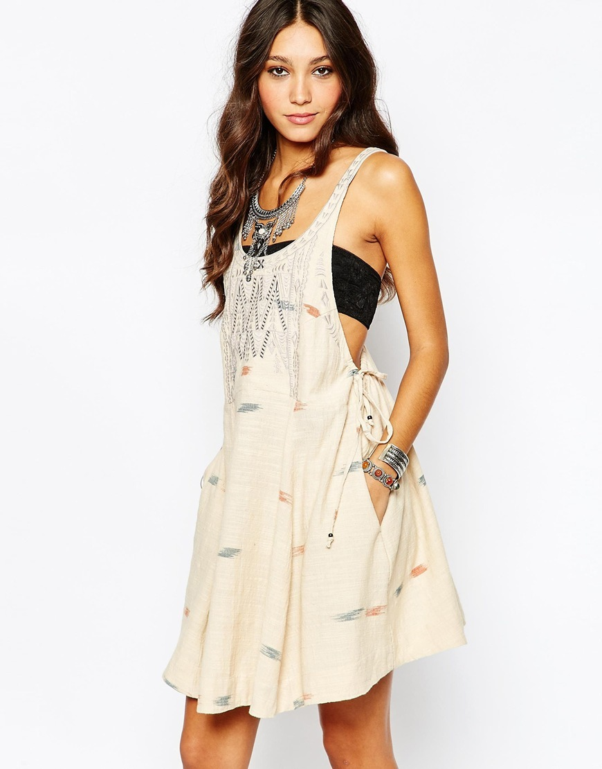 Arizona Mini Dress In Tea Combo Tea Combo - length: mid thigh; sleeve style: standard vest straps/shoulder straps; fit: loose; style: sundress; predominant colour: nude; occasions: casual, holiday; neckline: scoop; fibres: cotton - 100%; hip detail: soft pleats at hip/draping at hip/flared at hip; sleeve length: sleeveless; texture group: cotton feel fabrics; pattern type: fabric; pattern: patterned/print; embellishment: embroidered; season: a/w 2015; wardrobe: highlight