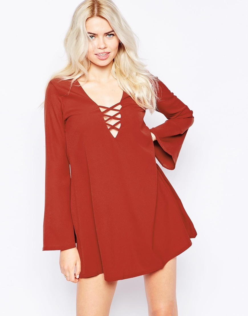 Swing Dress With Lace Up & Flare Sleeves Rust - style: smock; length: mini; neckline: low v-neck; sleeve style: angel/waterfall; fit: loose; pattern: plain; predominant colour: terracotta; occasions: casual, evening; fibres: polyester/polyamide - 100%; sleeve length: long sleeve; texture group: crepes; pattern type: fabric; season: a/w 2015; trends: folky 70s; wardrobe: highlight; embellishment location: bust