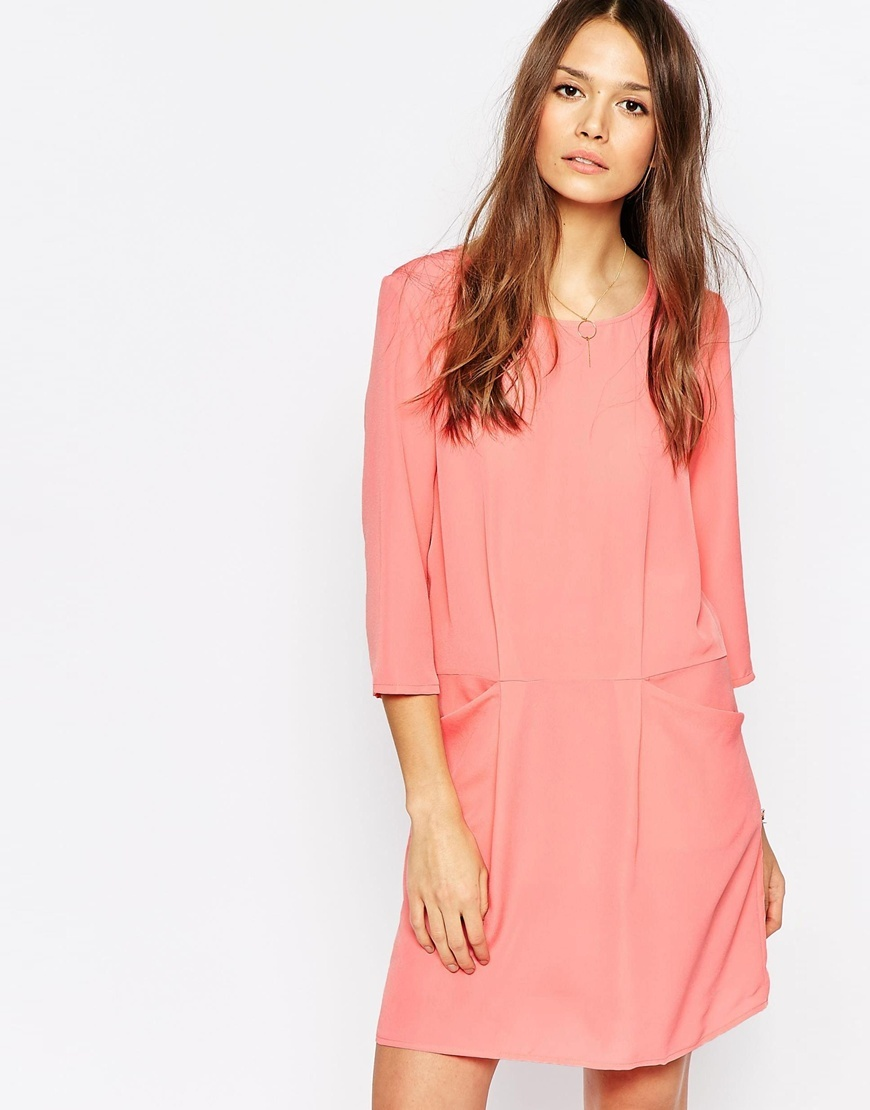 3/4 Sleeve Shift Dress With Front Pockets Salmon Rose - length: mid thigh; neckline: round neck; pattern: plain; style: blouson; waist detail: flattering waist detail; predominant colour: pink; occasions: casual; fit: soft a-line; fibres: polyester/polyamide - 100%; sleeve length: 3/4 length; sleeve style: standard; pattern type: fabric; pattern size: standard; texture group: jersey - stretchy/drapey; season: a/w 2015; wardrobe: highlight