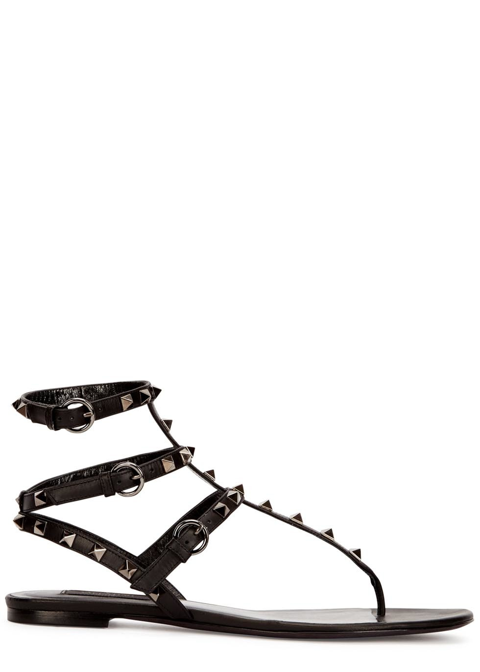 Rockstud Black Leather Sandals - secondary colour: silver; predominant colour: black; occasions: casual, creative work; material: leather; heel height: flat; embellishment: studs; ankle detail: ankle strap; heel: standard; toe: toe thongs; style: standard; finish: plain; pattern: plain; season: a/w 2015; wardrobe: highlight