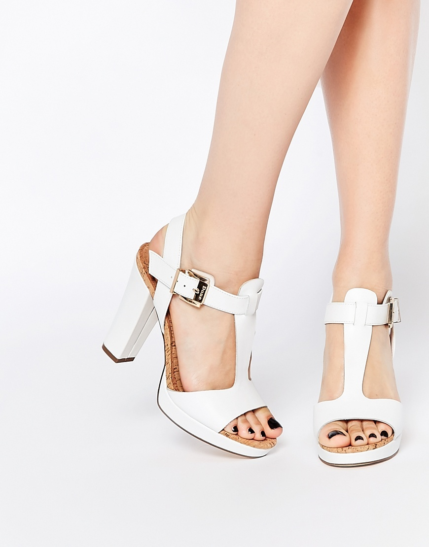 Ismin White Leather & Cork Heeled Sandals White - predominant colour: white; occasions: evening, occasion; material: leather; heel height: high; ankle detail: ankle strap; heel: standard; toe: open toe/peeptoe; style: strappy; finish: plain; pattern: plain; season: a/w 2015; wardrobe: event